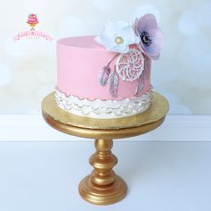 Buttercream birthday cake with dream catcher, wafer paper flowers, and fondant ruffles