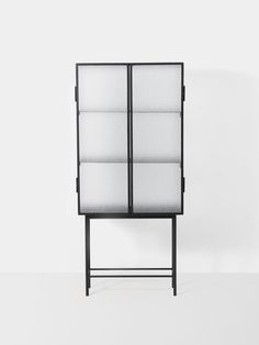 Opposites attract on this freestanding cabinet, crafted from sleek powder coated metal and wired glass. FAST DELIVERY - DANISH DESIGN