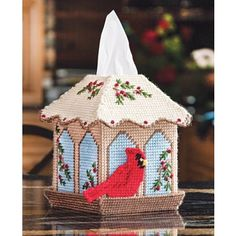 My favorite source for arts and crafts:  Bird Feeder Tissue Box Cover Plastic Canvas Kit I did this for my mom!