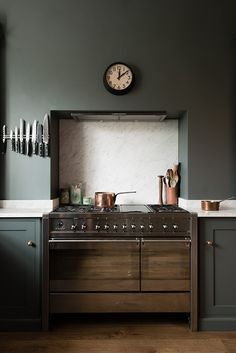 coloured kitchen and a big stove in the forefront... the bloomsbury kitchen
