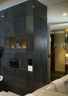 Slate tiles on the walls creates a sleek, modern look