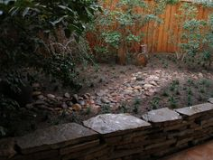 pavestone wall by Baldi gardens