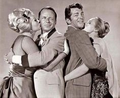 Anita Ekberg, Frank Sinatra, Dean Martin, and Ursula Andress snuggle up in '4 for Texas', 1963.