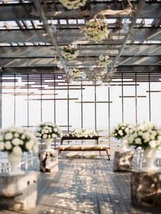 Floral lined ceremony: http://www.stylemepretty.com/2014/10/06/classic-white-wedding-in-bali/ | Photography: Angga Permana - http://anggapermanaphoto.com/