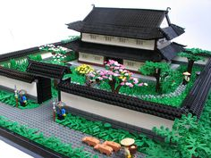 "this is called, ""Samurai House 2."" the detail on this black and white Japanese temple/house and gardens is beautiful. i LOVE the guy out front herding his pigs along...seriously...its awesome.  the roof on this is absolutely insane, and the builder did a really good job with the landscaping."