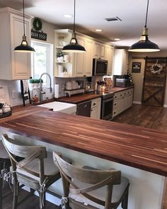 Love love love the butcher block counter top. Love the color of the cabinets. The barn door and farm sink with window over top #woodcountertopskitchenrustic