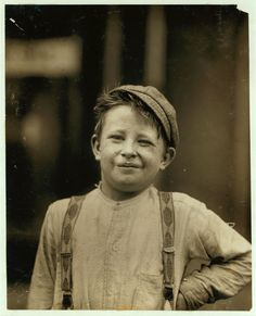 "Donald Mallick, (""Happy""), 203 King Street. 9 years of age, selling newspapers 5 years. Average earnings 35 cents a week. 1910, by Lewis W. Hine"