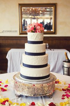 Wedding Cake With Coral Flowers and Navy Blue Ribbon! ..... This is the best one yet! REALLY love everything about this. Only thing I'd do is switch out the type of flowers!