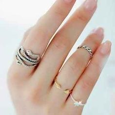 Or mix gold and silver.   The Art Of Wearing Adorable Tiny Rings