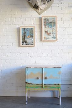 i don't know what's better- the cropped paint by numbers in new frames or the handpainted cabinet.  love it. via poppytalk - New Knack Studios Collaborations