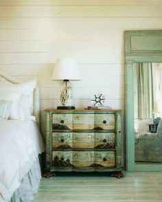 slat walls whitewashed.  cute bed table.