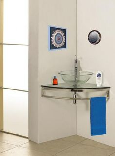 small corner bathroom sink with towel bar underneath, site has other ideas for small baths as well