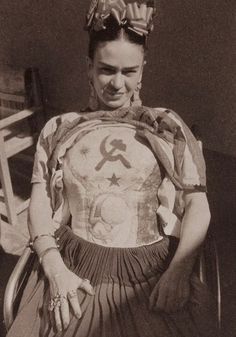 This photograph shows Frida Khalo's body cast done up in political revolution.