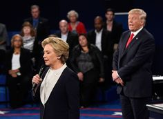<p>Democratic presidential nominee Hillary Clinton, left, talks as Republican presidential nominee Donald Trump watches her during the second presidential debate at Washington University in St. Louis, Sunday, Oct. 9, 2016. (Saul Loeb/Pool/Reuters)</p>