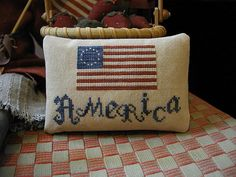 """Patriotic cross stitch """"America"""" pinkeep pattern from Threadwork Primatives, available on Etsy."""