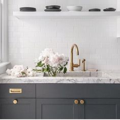 Brass hardware on grey cabinetry is seriously a match made in heaven 👌🏻 #loandcointeriors #brasshandles #brasshardware #brasstap #marble