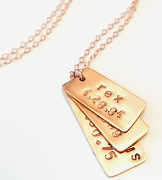 Keep a set of notes, short and sweet, close to the chest with this bar necklace. Formed by hand in silver, gold or rose gold, three polished rectangles are layered to form a pendant and strung on a delicate chain. Stamp them with the names of your kids (human or furry), your closest friends' initials, sets of coordinates or anniversary dates.