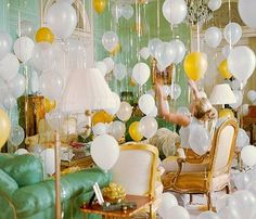 Room filled with balloons at different heights