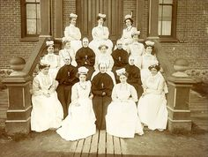 School of Nursing group with Sisters of Providence, Providence Sacred Heart Medical Center, Spokane, Washington, 1907 - Like the poofy caps, and the strained faces.   I'd end up being the one on the far right, second row.