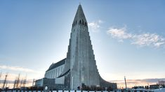If you are coming to Iceland, you'll need to visit the Hallgrímskirkja church at least once! This stunning landmark is one of the most famous buildings in Iceland, and it's worth every minute spent admiring its architectural beauty. The tower has a height of 74,5 meters and can be seen from all around the city. So if you're looking for an easy way to spot your bearings when exploring the capital, just follow the Church Tower!