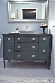 Old dresser as vanity. I kind of like this blue/gray color. Interesting idea.... have to keep this in mind for when we build in NY
