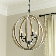 Love this pendant light from Ballard Design.........Hudson 4-Light Pendant w/ distressed wood