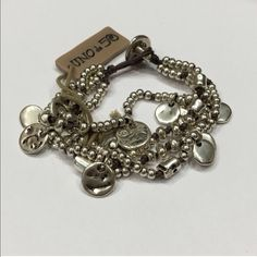 """NWT UNOde50  """"Waterfallita"""" Bracelet Authentic NWT Unode50 Wide Bracelet made up of various strands of brown leather with silver plated and pearl beads interspersed with small knots.  7.5"""" Retail $165.  Red Uno pouch included Uno de 50 Jewelry Bracelets"""