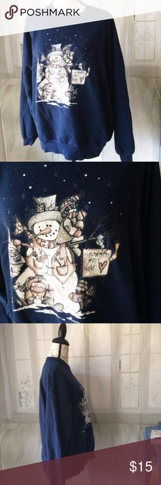 "Jerzees Navy Snowman Sweatshirt 2X This is 50% cotton 50% polyester and is made in the USA. You can machine wash it. It does have some wear so expect some cracks on the snowman graphic, fading, and pilling on the inside. It is still very wearable. The graphics says ""Snowmen melt your heart"". It's a really fuzzy long sleeved sweatshirt that's perfect for cold winter nights. Jerzees Tops Sweatshirts & Hoodies"