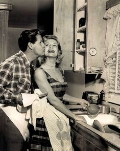What a beautiful couple of husband and wife working together in the kitchen.  Nothing like today's wives stating a kitchen is only for the woman.