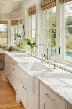 white kitchen and wall of windows