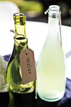 Repurposed wine bottle with water tag. Forget buying fancy pitchers! This would be perfect for serving water, iced tea and lemonade for entertaining! Could even chill in an ice bucket right alongside the wine.