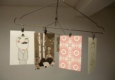 vintage wire hanger: cute way of displaying prints or photos