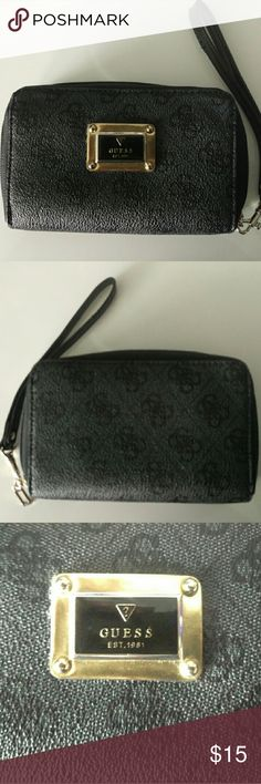 Guess wristlet, wallet / clutch Guess black wristlet type wallet with removable strap.  Zipper closure Many compartments for cards ect. and it is wide enough to fit a cell phone. Like new, no rips, stains or fading.  No pet, no smoking home. Guess Bags Clutches & Wristlets
