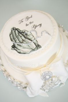 religious cake - handpainted by my 15 year old daughter,jorene  brooch + rosary made out of mould made by me  100+ scrunch roses handmade and handpainted by edda + jorene  top tier: chocolate cake with chocolate custard filling IMBC  bottom tier: cookies and cream, TFL