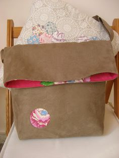 Singoalla, fold over bag with patchwork detail.