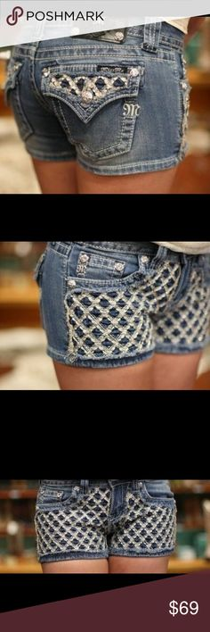 """Paradise Cross Stitched Miss Me Shorts Miss Me Women's Jean Shorts Paradise Cross Stitch Western WearMedium wash denim shorts with fading through out. The front of the shorts are detailed with an embroidered cross stitch pattern accented with rhinestones. Shorts feature flap back pockets with cross stitch pattern, medium stitch detail, and silver logo hardware throughout. 3 1/2"""" Inseam 7 1/2"""" Front Rise 20 3/4"""" Leg Opening 98% Cotton 2% Elastane. Style # JP6176H. ❣Gently Preloved from My…"""