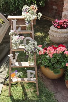 Step ladder decorated with flowers and LOVE lettering | Photography by http://www.gabriellebower.co.uk/