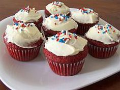 Red Velvet Cupcakes with red, white and blue sprinkles - What could be more patriotic for the 4th of July?
