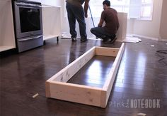 create a wooden platform that is tightly secured to the floor. We used 2″x6″wood to prop our cabinets at our desired height of 36″.