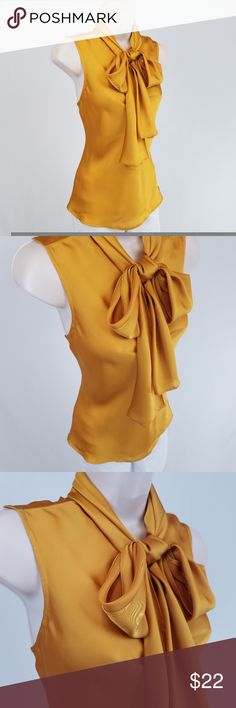 Nine West sleeveless pussy bow top Sleeveless pussy bow top in silky mustard yellow.  Washed but never worn.  Tiny spot near neckline in back (see photo 4); not noticeable.  Looks great layered under a cardigan or jacket.  Bust 19 / length 22.5 inches.  100% polyester. Nine West Tops