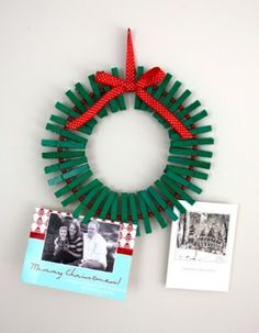 Clothespin card hanging wreath    Wondering what to do with all those holiday cards from family and friends?  Well, this clothespin wreath is your answer. Display all those beautiful faces and warm holiday messages from family and friends and your home will be filled with love