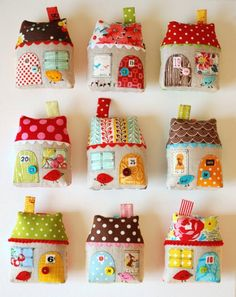 Fabric house ornaments  http://quilting.craftgossip.com/diy-fabric-house-ornament/2011/11/03/