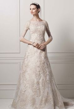 Brides: Oleg Cassini at David's Bridal. 3/4 illusion sleeve lace A-line gown.��See More Oleg Cassini Gowns from David's Bridal