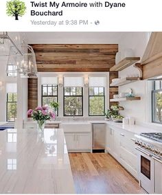 Bright white kitchen - floating shelves - wood accent wall
