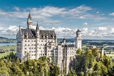 Schloss  Neuschwanstein (Germany). 'Bavaria's best-known  castle emerges  from hilltop woodland above  Füssen like a bedtime storybook  vision. Commissioned  by Ludwig II, 19th-century  king of Bavaria, Neuschwanstein  is top of the league  when it comes to Germany's  tourist attractions and it's  easy to see why.' http://www.lonelyplanet.com/germany/sights/castle/schloss-neuschwanstein