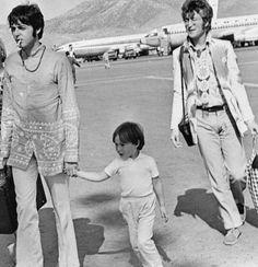 """Hey, Jules, don't be afraid..."": Paul McCartney arriving hand in hand with Julian Lennon, John's 1st son."