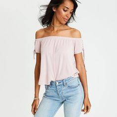 AE Soft & Sexy Grommet T-Shirt ($30) ❤ liked on Polyvore featuring tops, t-shirts, pink, off shoulder t shirt, pink off shoulder top, pink off the shoulder top, lace up t shirt and lace up top