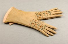 pale yellow gloves, circa 1700-1710, of kid leather suede side uppermost. The Worshipful Company of Glovers of London