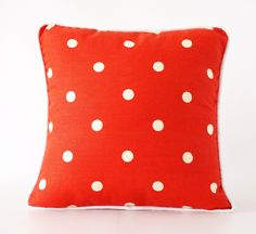 Red pillow cover with white polka dots and trim
