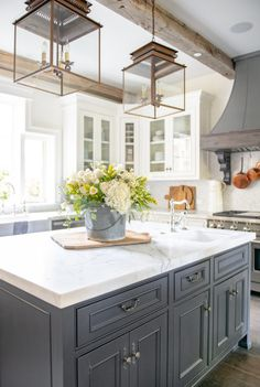 Country Kitchen with Dark Center Island-double lantern pendants-honed marble countertops-white glass cabinets-french range hood Country Kitchen Designs, French Country Kitchens, Rustic Kitchen Design, Modern Farmhouse Kitchens, Home Decor Kitchen, Home Kitchens, Kitchen Dining, Kitchen Ideas, Kitchen Country